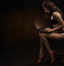 Sexy Woman Viewing Laptop